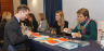 Business students at John Cabot University meet with potential employers at a recent Career Fairs on campus