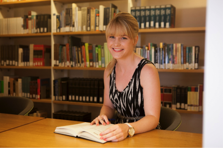 A JCU student does research at the campus library