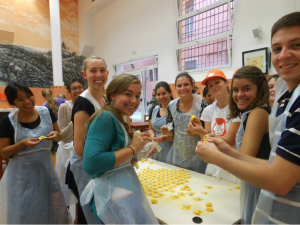 Students learn how to cook fresh pasta in one of JCU's many cooking classes.