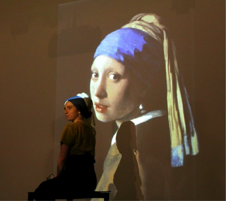 "A JCU art student re-enacts the Renaissance masterpiece ""Girl with a Pearl Earring"" during a fundraising event"