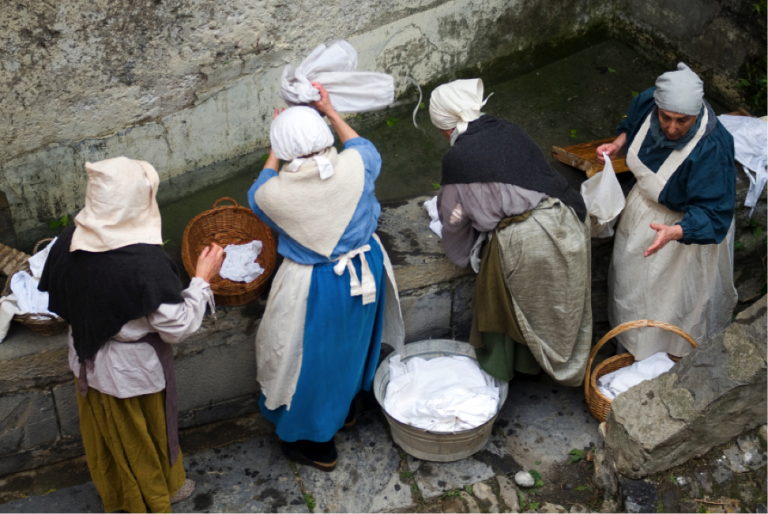 Local women participate in a historical re-enactment of medieval laundering in Taggia, Italy.