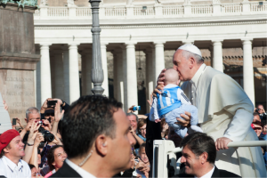 Pope Francis greets crowds in the Vatican, just a short bus ride away from John Cabot University