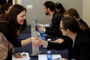 A student (left) connects with local professionals at John Cabot's Career Fair.