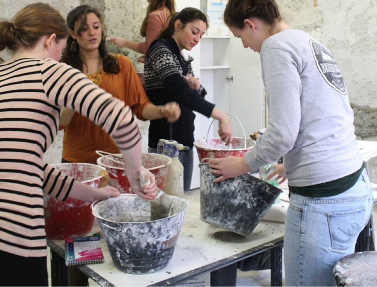 Study abroad students mix plaster for their frescoes in JCU's art studio