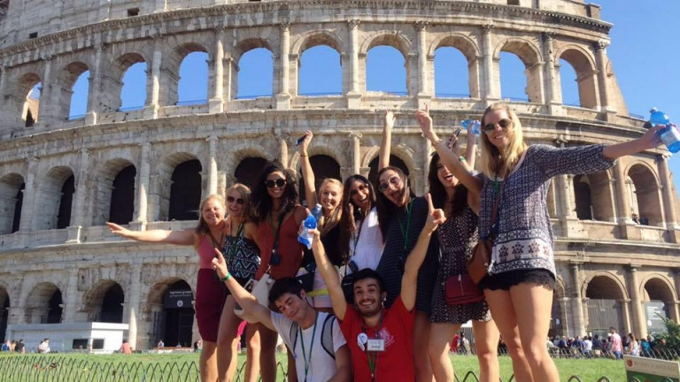 John Cabot University students at the Colosseum, one of the most famous relics of Ancient Rome