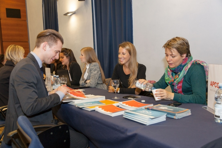 A student meets with international consulting firm APCO at John Cabot University's career fair