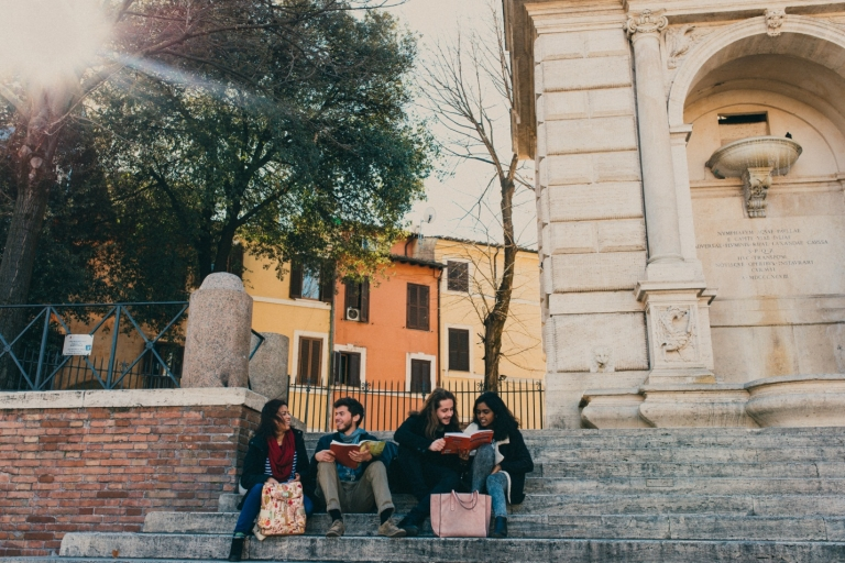 JCU students exchange ideas and study together on some of Rome's sunny steps