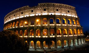 Rome, Italy's Colosseum at night. Built by Vespasian and dedicated in 80 AD, the Colosseum has been a symbol of Rome for 2 000 years. Gladiators fought animals and themselves, sometimes to the death, for over 300 years in this arena.