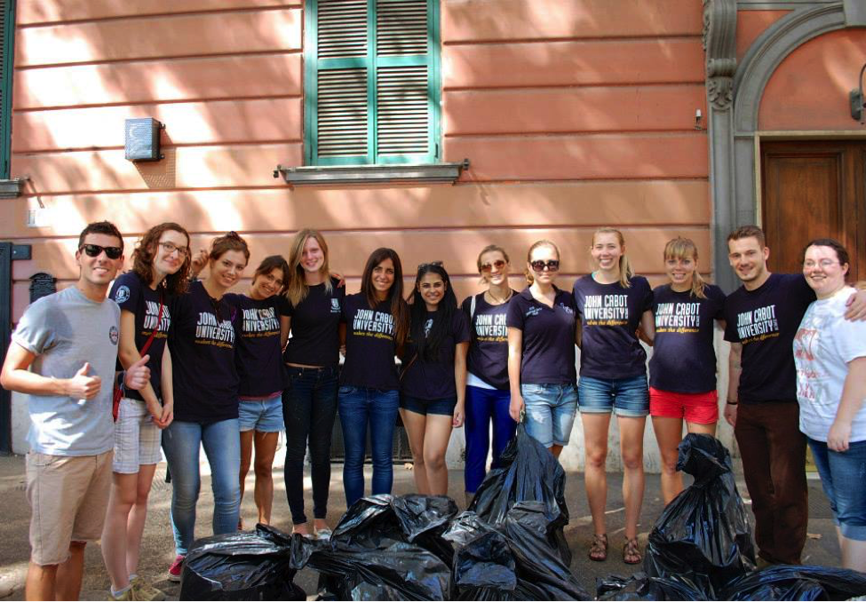 JCU students get involved with the community and clean local parks, Two John Cabot University students at the Guarini Campus, Ways to Meet New People while you Study Abroad in Rome, making friends in college, international schools in Rome, JCU cooking class