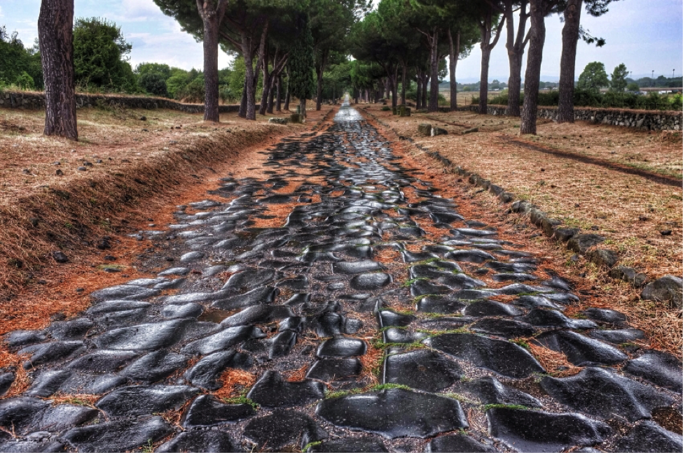 A stretch of the Appian Way, Students examine ancient building materials, JCU on-site classes, class at john cabot university, study abroad in Rome, Inventions that Shaped the History of Ancient Rome, learning about italy as a study abroad student