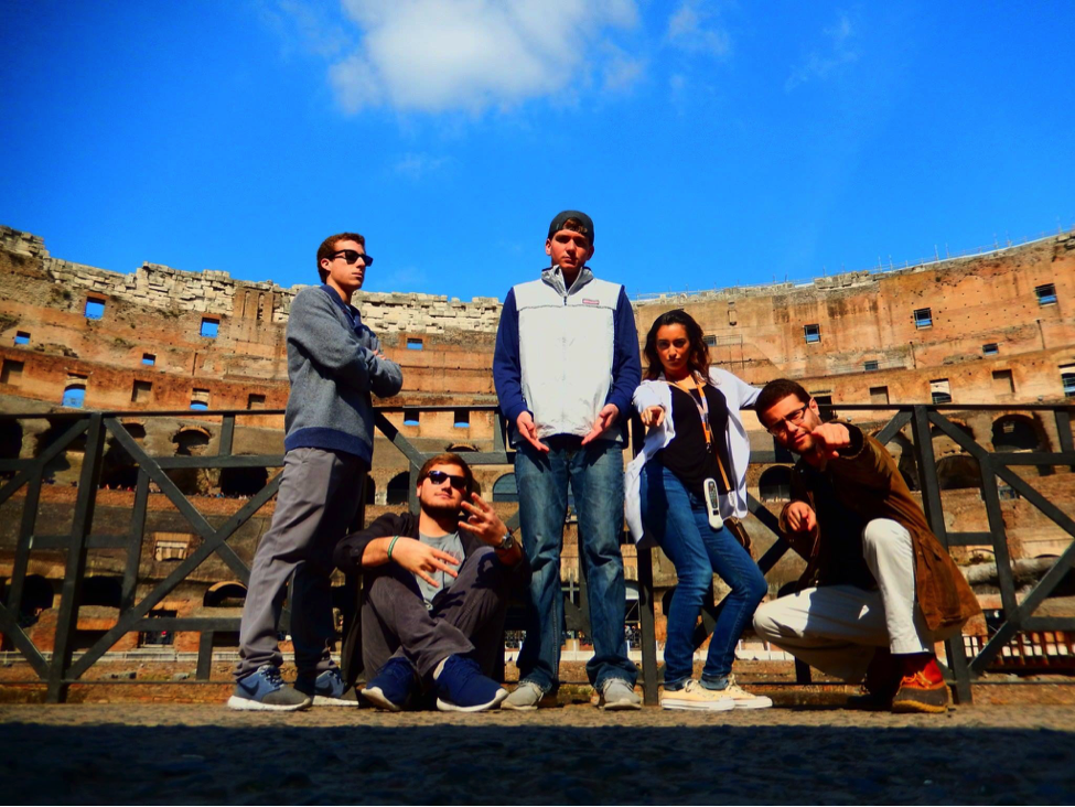John Cabot University students have fun posing outside the Colosseum