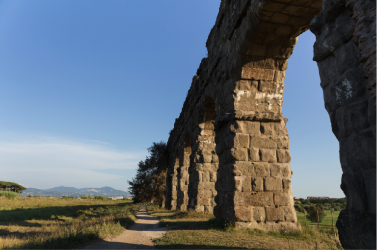 Roman aqueduct, Students examine ancient building materials, JCU on-site classes, class at john cabot university, study abroad in Rome, Inventions that Shaped the History of Ancient Rome,