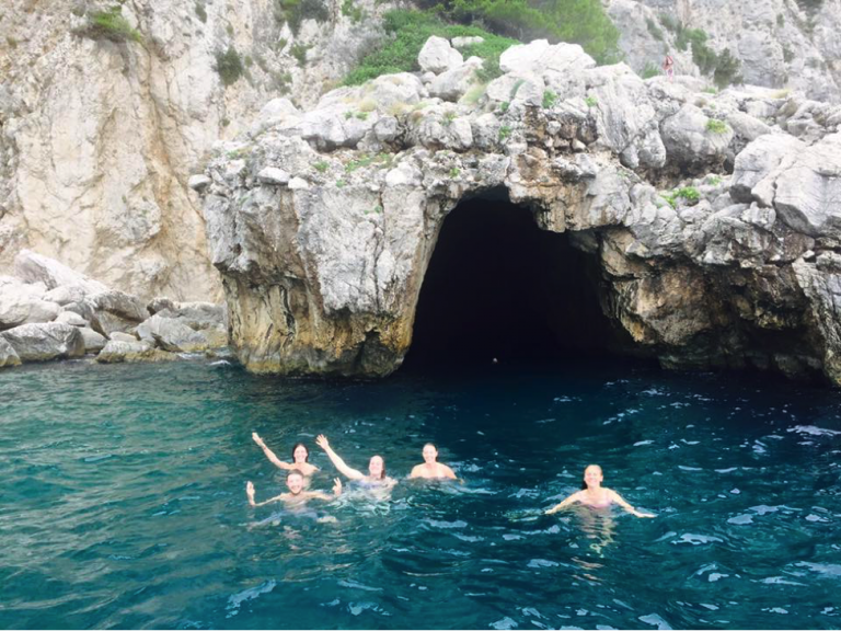 JCU students swim near a cave on Capri's coast.