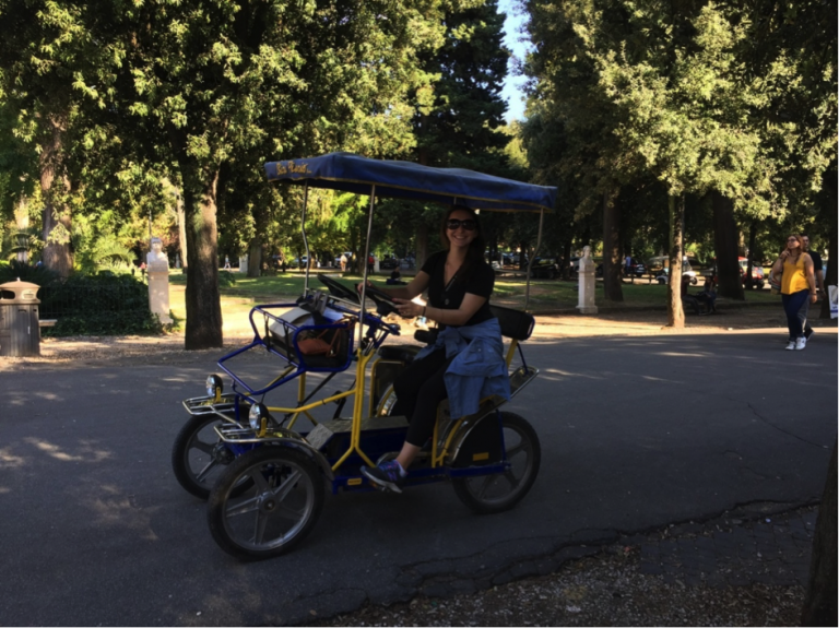 A JCU student tours Villa Borghese Park in one of the city's unique tandem rental bikes