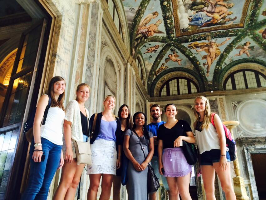 Students admire Renaissance frescoes during their on-site art history classes