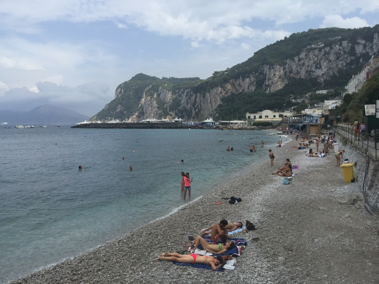 JCU students relax on a beach along the Coast of Capri