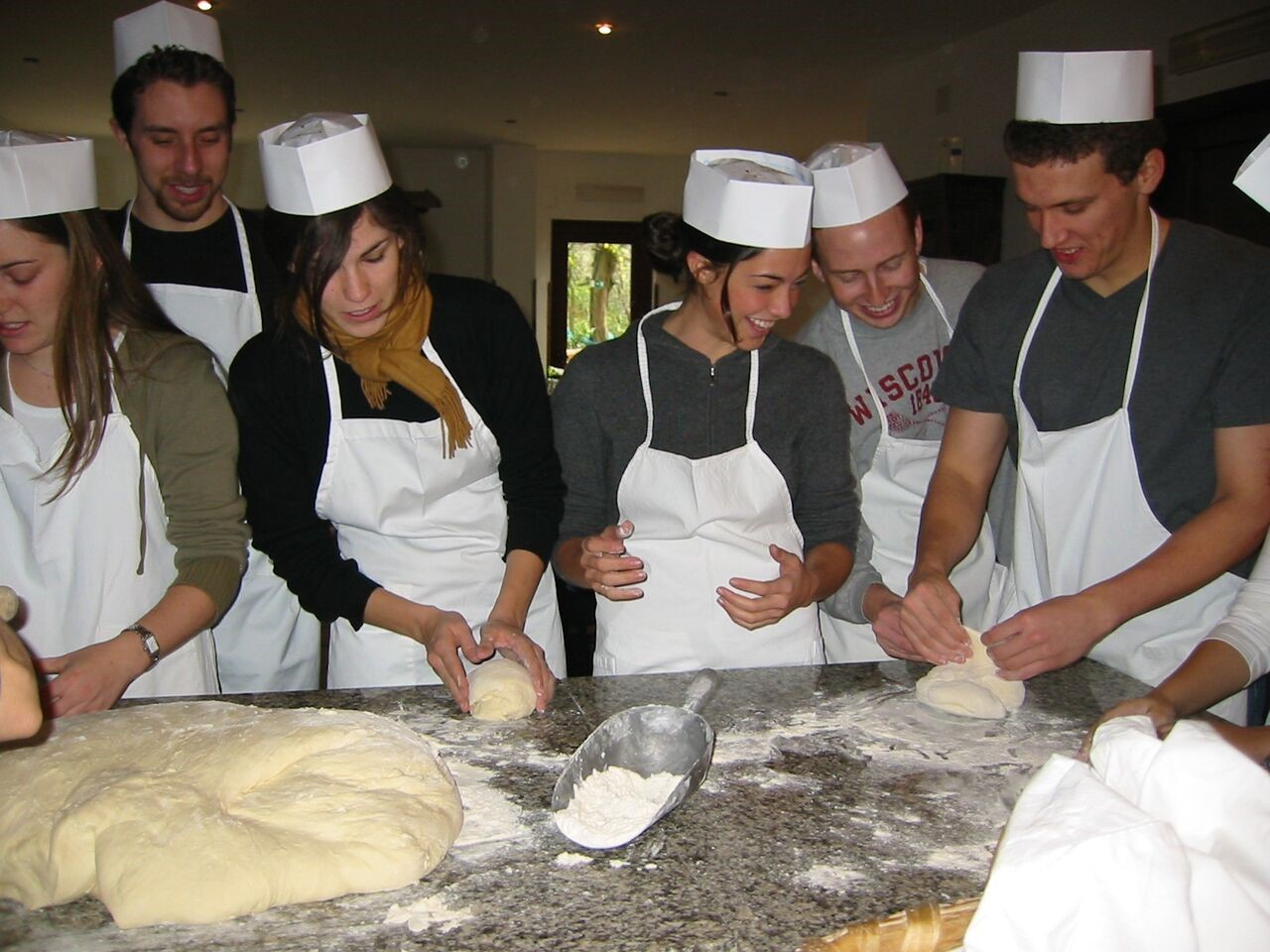 Students learn traditional Italian pasta-making at a JCU-hosted cooking class