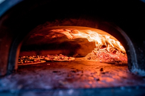 Roman-style pizza must be cooked in a wood-burning oven, to give it its distinct texture and taste